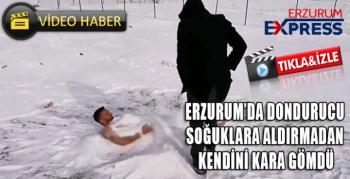 Dondurucu soğuklara aldırış etmeden kendisini kara gömdü